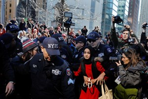 Thumbnail 246916 USA   NYPD officers arrest a woman who was taking part in a  Day Without a Woman  march | © Lucas Jackson/REUTERS
