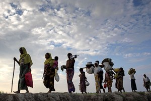 Thumbnail 246826 BANGLADESH-Rohingya refugee people walk through paddy field  | © K M Asad/LightRocket/Getty Images